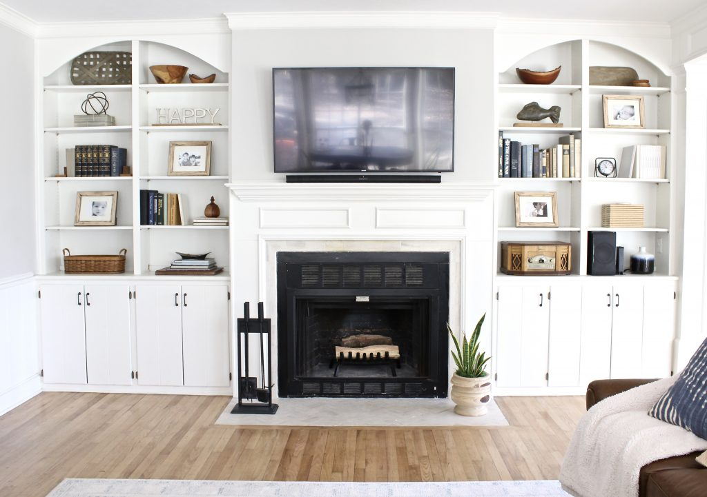 White Built In Shelves With Natural Wood Metals And Books